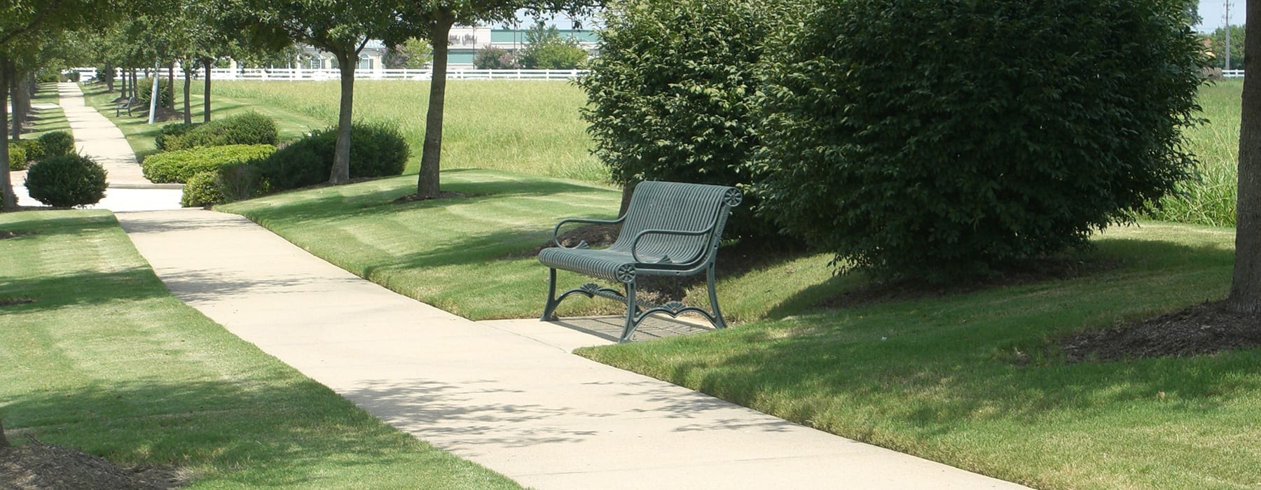 rolling hills, walkways and a bench in nearby neighborhood